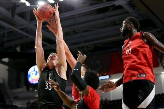 Cincinnati Bearcats center Chris Vogt (33) pulls down a rebound during midnight madness , Saturday, Oct. 5, 2019, at Fifth Third Arena in Cincinnati.