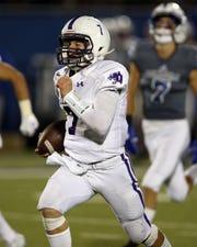 Elder quarterback Matthew Luebbe runs for a touchdown. Elder defeated Saint Xavier 31-28 Oct. 4.