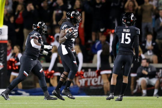 Cincinnati Bearcats defensive end Malik Vann (42) celebrates a fumble recovery in the second quarter of a college football game against the UCF Knights, Friday, Oct. 4, 2019, at Nippert Stadium in Cincinnati.