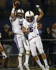 Elder quarterback Matthew Luebbe and teammate Dakota Postel celebrate a touchdown. Elder defeated Saint Xavier 31-28 Oct. 4.