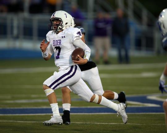 Elder quarterback Matthew Luebbe runs for a first quarter touchdown against St. Xavier Oct. 4.