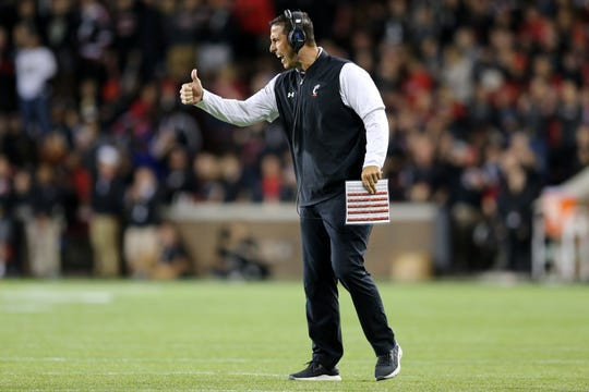 Cincinnati Bearcats head coach Luke Fickell encourages the team in the third quarter of a college football game against the UCF Knights, Friday, Oct. 4, 2019, at Nippert Stadium in Cincinnati.