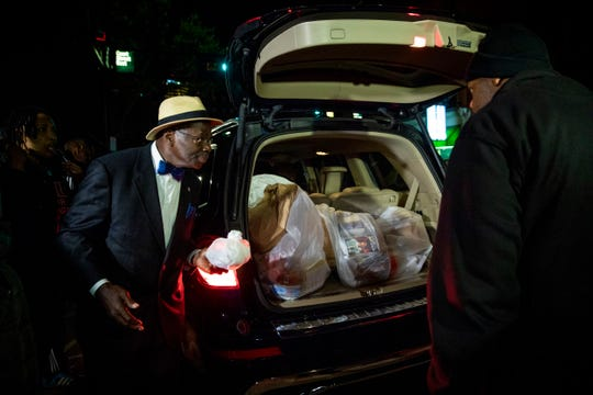 Supporters of former juvenile court judge Tracie Hunter load her belongings into her vehicle after her release from the Hamilton County Justice Center in downtown Cincinnati Saturday, October 5, 2019.