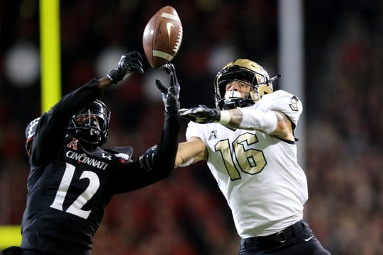 Cincinnati Bearcats cornerback Ahmad Gardner (12) intercepts a pass intended for UCF Knights wide receiver Tre Nixon (16) in the third quarter of a college football game, Friday, Oct. 4, 2019, at Nippert Stadium in Cincinnati.
