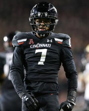 Cincinnati Bearcats cornerback Coby Bryant (7) celebrates a tackle for loss in the third quarter of a college football game against the UCF Knights, Friday, Oct. 4, 2019, at Nippert Stadium in Cincinnati.