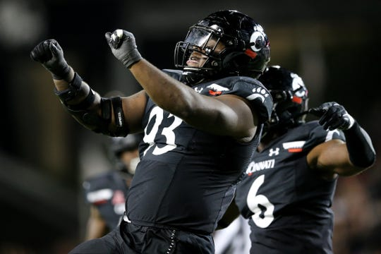 Cincinnati Bearcats defensive tackle Elijah Ponder (93) celebrates a sack in the fourth quarter of a college football game against the UCF Knights, Friday, Oct. 4, 2019, at Nippert Stadium in Cincinnati.