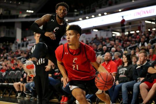 Cincinnati Bearcats guard Jaevin Cumberland (21) dribbles during midnight madness , Saturday, Oct. 5, 2019, at Fifth Third Arena in Cincinnati.