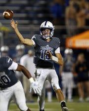 Saint Xavier quarterback Matthew Rueve attempts a pass in the second half. Elder defeated Saint Xavier 31-28 Oct. 4.