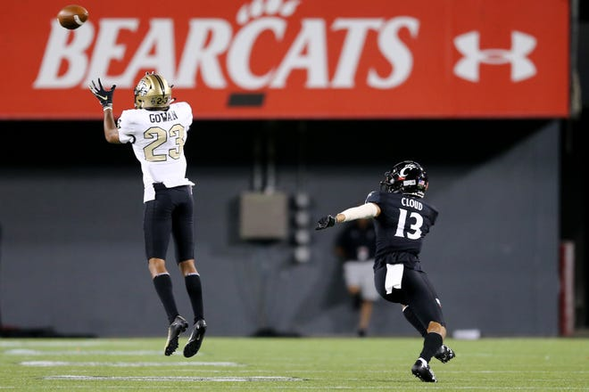 UCF Knights defensive back Tay Gowan (23) intercepts a pass intended for Cincinnati Bearcats wide receiver Trent Cloud (13) in the second quarter of a college football game, Friday, Oct. 4, 2019, at Nippert Stadium in Cincinnati.