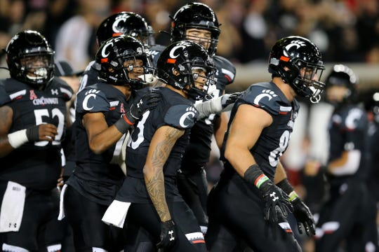 DUPLICATE***Cincinnati Bearcats wide receiver Trent Cloud (13), center, is congratulated after scoring a touchdown in the second quarter of a college football game against the UCF Knights, Friday, Oct. 4, 2019, at Nippert Stadium in Cincinnati.