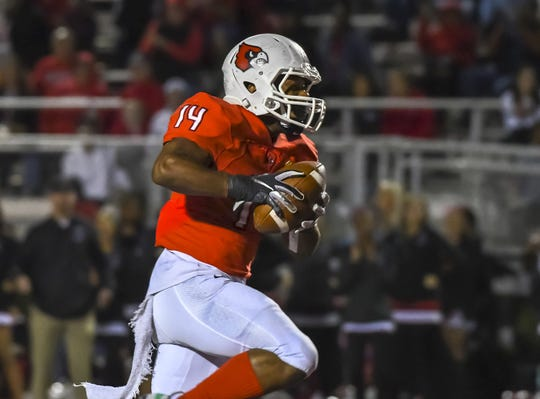 Hamzah Abdul-Waheed of Colerain carries the ball against Sycamore Friday, Oct. 4, 2019, at Colerain High School.