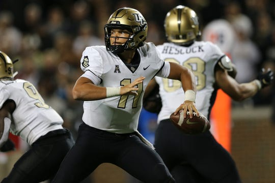 UCF Knights quarterback Dillon Gabriel (11) throws in the fourth quarter of a college football game against the Cincinnati Bearcats, Friday, Oct. 4, 2019, at Nippert Stadium in Cincinnati.