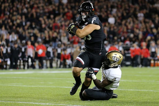 Cincinnati Bearcats tight end Josiah Deguara (83) eyes the end zone on a catch in the second quarter of a college football game against the UCF Knights, Friday, Oct. 4, 2019, at Nippert Stadium in Cincinnati.