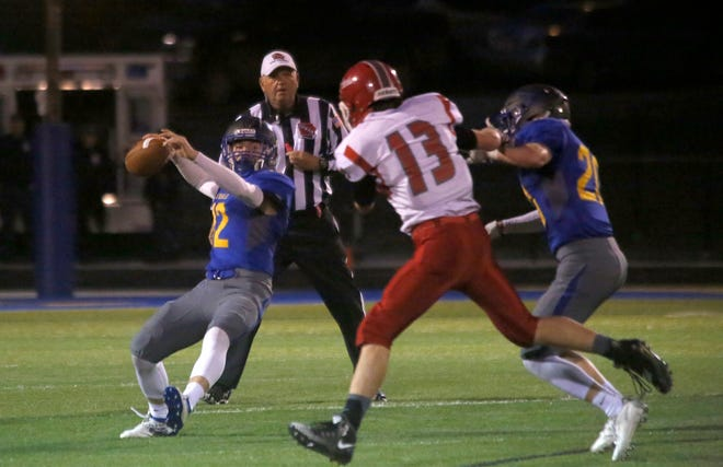 Martensdale-St. Marys junior quarterback Jack Franey gets a pass away. Martensdale-St. Marys hosted North Mahaska for homecoming on Oct. 4.