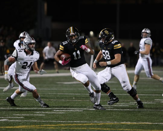 Oct 4, 2019; Altoona, IA, USA; SE Polk Rams Isaiah Wagner (11) runs the football against the Ankeny Centennial Jaguars at SE Polk High School. The Jaguars beat the Rams 20 to 17.  Mandatory Credit: Reese Strickland-special to the Herald.