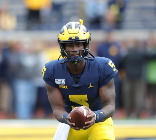 Michigan Wolverines quarterback Joe Milton (5) warm-up  before action against the Iowa Hawkeyes on Saturday, Oct. 5, 2019, at Michigan Stadium in Ann Arbor.
