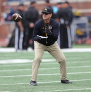 Jim Harbaugh on the field before action against Iowa on Oct. 5, 2019, at Michigan Stadium.