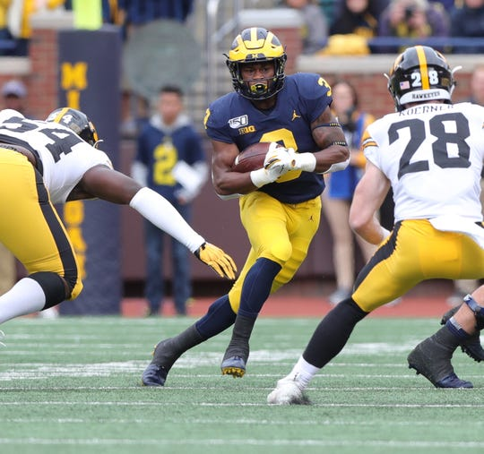 Michigan running back Christian Turner runs the ball against Iowa during the first half on Saturday, Oct. 5, 2019, at Michigan Stadium.
