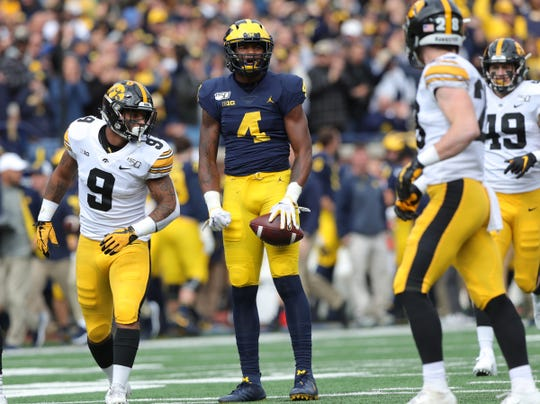 Michigan wide receiver Nico Collins celebrates after a catch against Iowa defensive back D.J. Johnson during the first half on Saturday, Oct. 5, 2019, at Michigan Stadium.
