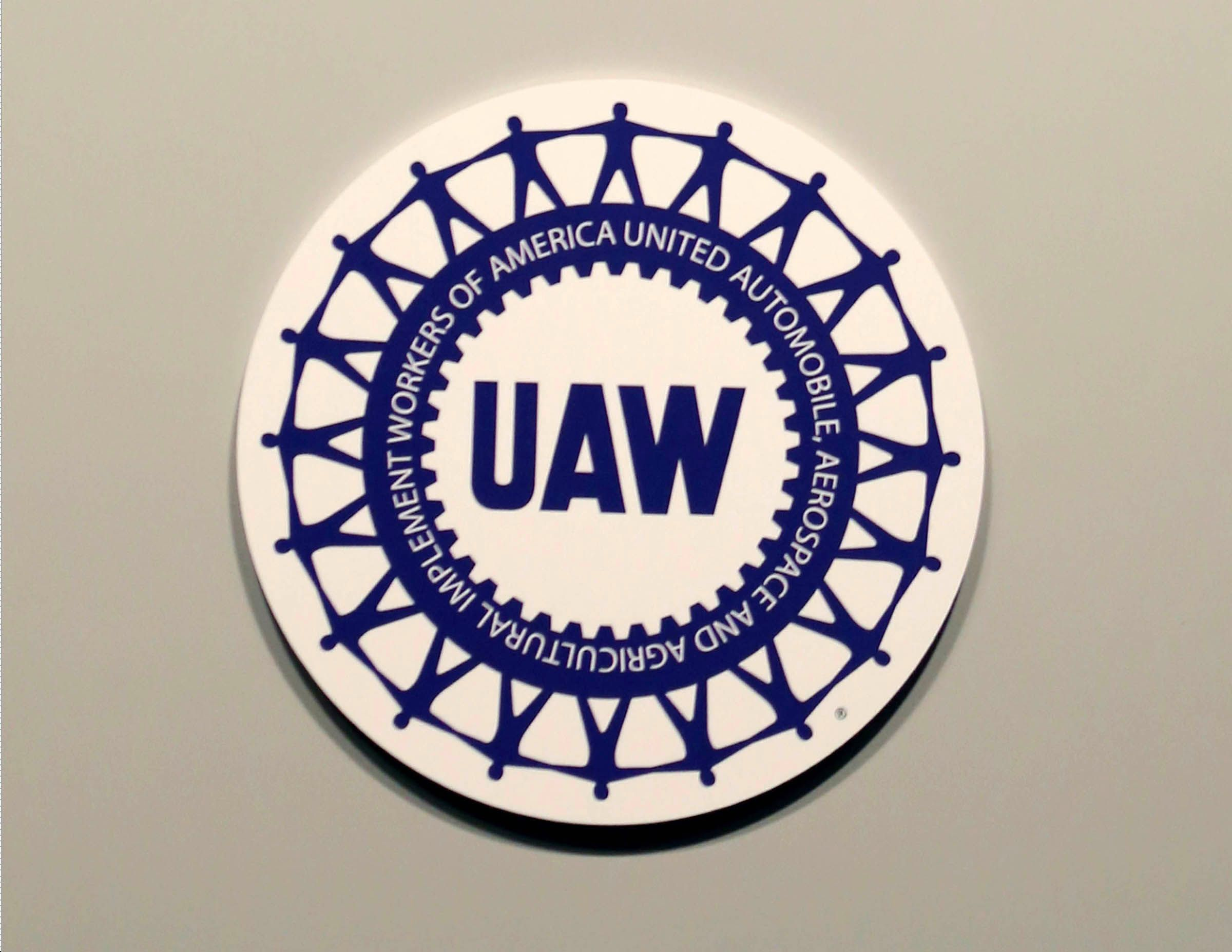 UAW regional director charged in corruption probe placed on leave as strike continues