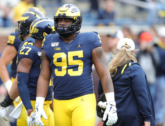 Michigan Wolverines defensive lineman Donovan Jeter (95) warms up before action against the Iowa Hawkeyes on Saturday, Oct. 5, 2019, at Michigan Stadium in Ann Arbor.