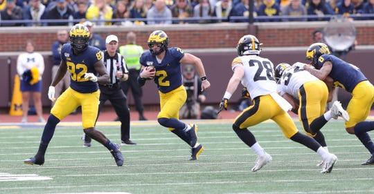 Michigan quarterback Shea Patterson runs against Iowa during the first half of U-M's 10-3 win on Saturday, Oct. 5, 2019, at Michigan Stadium.