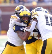 Michigan wide receiver Nico Collins is tackles by Iowa defensive back Michael Ojemudia during the second half of U-M's 10-3 win on Saturday, Oct. 5, 2019, at Michigan Stadium.