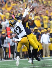 Michigan wide receiver Nico Collins makes a catch against Iowa defensive back D.J. Johnson during the first half on Saturday, Oct. 5, 2019, at Michigan Stadium.