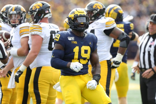 Michigan Wolverines defensive lineman Kwity Paye celebrates his sack against the Iowa Hawkeyes during the first half Saturday, Oct. 5, 2019 at Michigan Stadium in Ann Arbor.