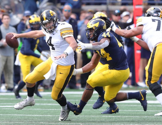 Michigan linebacker Cameron McGrone sacks Iowa quarterback Nate Stanley during the second half of U-M's 10-3 win Saturday, Oct. 5, 2019, at Michigan Stadium.