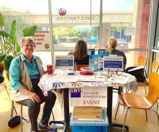 Barbara Cherem, of the League of Women Voters, hands out educational material to patrons at the Sweetwaters Coffee & Tea in Ann Arbor on Sept. 24, 2019.