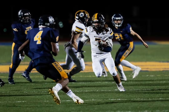 Port Huron Northern running back Theo Ellis runs against Fraser during the first half in Fraser on Friday.