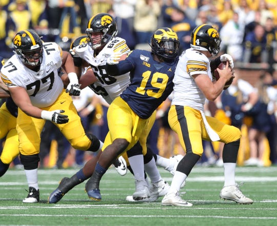 Michigan defensive lineman Kwity Paye sacks the Iowa quarterback Nate Stanley during the first half on Saturday, Oct. 5, 2019, at Michigan Stadium.