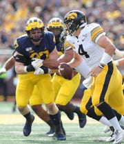 Michigan defensive lineman Aidan Hutchinson pursues Iowa quarterback Nate Stanley during the second half of U-M's 10-3 win on Saturday, Oct. 5, 2019, at Michigan Stadium.