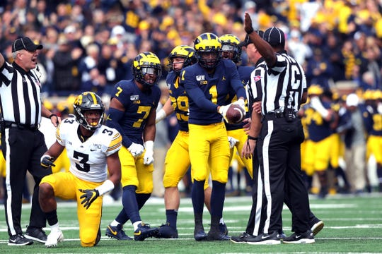Michigan defensive back Ambry Thomas recovers a fumble by Iowa wide receiver Tyrone Tracy Jr. (3) during the first half on Saturday, Oct. 5, 2019, at Michigan Stadium.