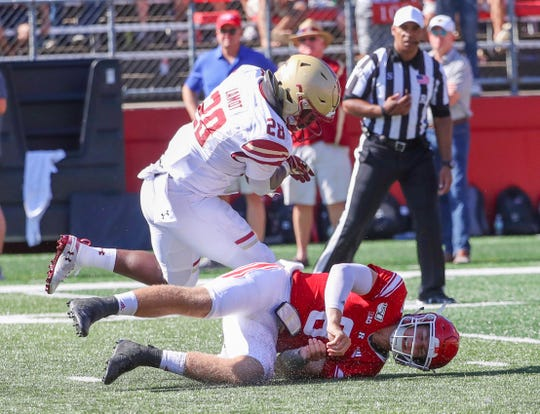 Rutgers quarterback Art Sitkowski (8), here being knocked to the ground in against Boston College Sept. 21, asked not to play against Maryland so he could remain eligible for a redshirt.