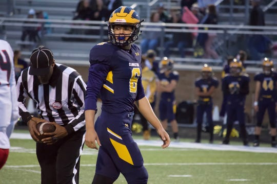 Clarkston sophomore quarterback Mike DePillo glances toward the Southfield A&T sideline in the first quarter on Friday.