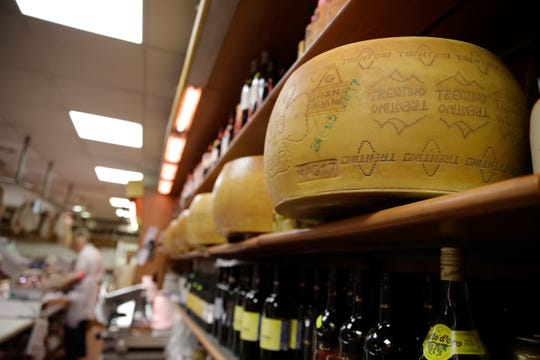 Wheels of parmesan cheese are stored in a deli in Rome, Thursday, Oct. 3, 2019. The U.S. had prepared for Wednesday's ruling and already drawn up lists of the dozens of goods it would put tariffs on. They include EU cheeses, olives, and whiskey, as well as planes, helicopters and aircraft parts in the case _ though the decision is likely to require fine-tuning of that list if the Trump administration agrees to go for the tariffs.