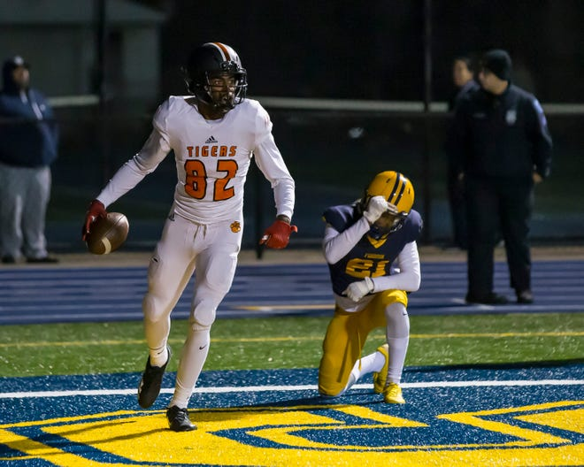 Belleville's Connor Bush (82) hauled in the winning touchdown against Dearborn Fordson.