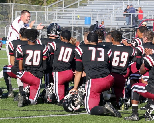 Elmira head coach Jimmy McCauley and his players celebrate their 63-35 win over Binghamton on Oct. 5, 2019 at Ernie Davis Academy.