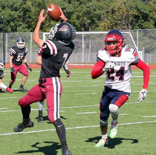 Elmira's Jared Alford reaches up to make a catch as Binghamton's Ty Wooden defends Oct. 5, 2019 at Ernie Davis Academy.