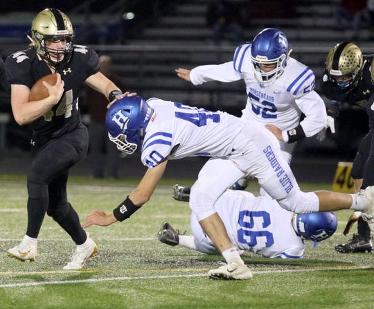 Dillon Kennedy carries the ball for Corning as Nate Ham of Horseheads tries to make the tackle Oct. 4, 2019 at Corning Memorial Stadium.