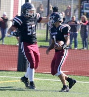 Elmira lineman Matt Coon (58) celebrates with Ethan Simpson (2) after Simpson ran for a touchdown in a 63-35 win over Binghamton on Oct. 5, 2019 at Ernie Davis Academy.
