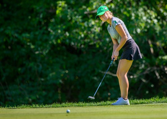 Destynie Sheridan rolls a putt at Prairie View Golf Club. The North Huskies finished second to Homestead.