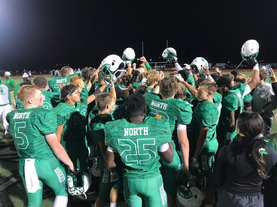 The North football team celebrates after defeating Reitz 17-13. It was their first win over the Panthers since 2006.