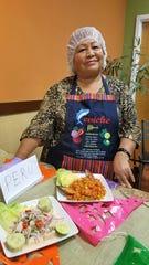 Gloria Bautista Ascencio with ceviche and arros con mariscos before the 2017 Fiesta Evansville.