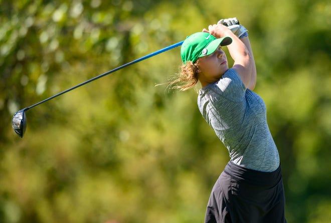 Faith Johnson hits a tee shot at Prairie View Golf Club. The North sophomore won the individual state title.
