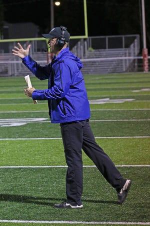 Danbury coach Keith Mora instructs his defense.