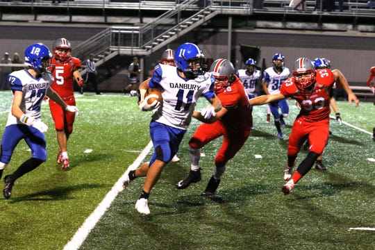 Danbury's Tommy Owens carries the ball against SJCC.