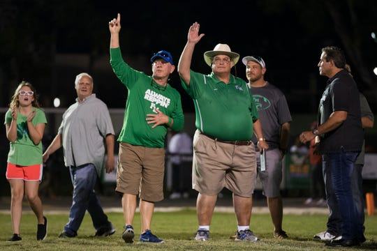 Members of Fort Myers High School's 1975 football team were honored on Friday during halftime of the Green Wave's game against Dunbar at Fort Myers. Fort Myers beat Dunbar 16-6.